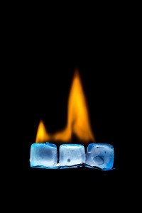 Burning ice cubes on a dark background.