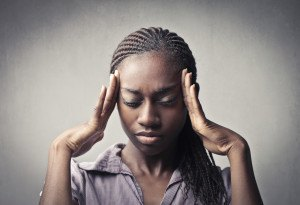 African young woman suffering from headache
