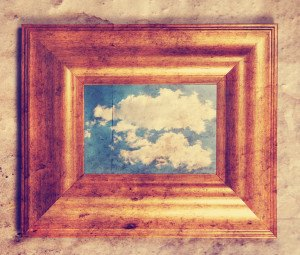 a distressed frame with a cloud in it toned with a retro vintage