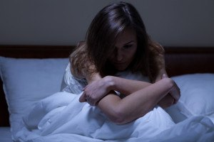 View of awake woman suffering from depression
