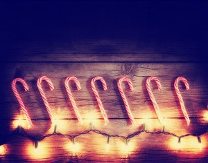 a row of candy canes and christmas lights toned with a retro vin