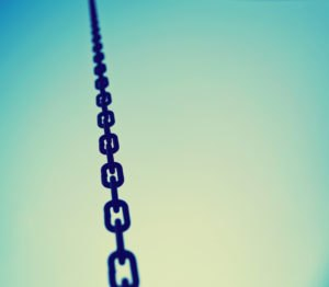 a big metal chain going up to the sky toned with a retro vintage