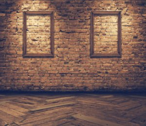 old grunge interior with blank frames against wall, retro filter