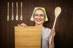 Funny Rural Woman Cook Holding Ladle And Chopping Shim, Close-up